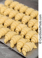 Beautiful classic crescent rolls on a tray