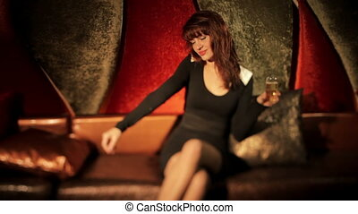 beautiful classic pin-up girl in a VIP club drinking a ...