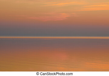 Beautiful clear background sunset color over the lake