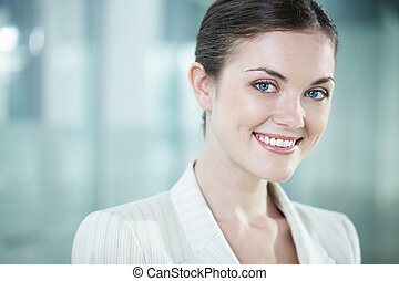 Beautiful clerk - Portrait of a beautiful woman looking at...