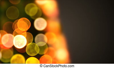 Beautiful Close-up Christmas Tree Lights Flickering and Turning in Blur Bokeh. Looped 3d Animation. Merry Christmas and Happy New Year Concept. 4k Ultra HD 3840x2160
