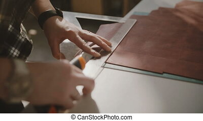Beautiful close-up shot of female hands cutting big leather...