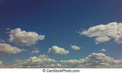 Beautiful clouds float across blue sky. Time Lapse