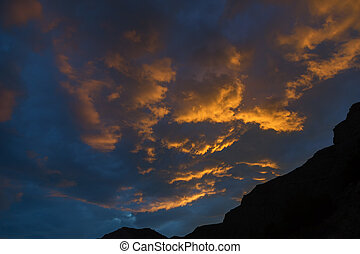 Beautiful clouds illuminated by setting sun in the sky
