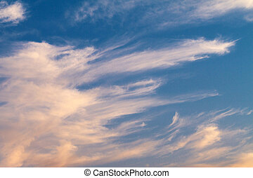 beautiful clouds of pink at sunset in the blue sky
