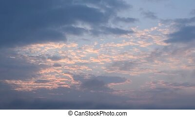Beautiful clouds on background of blue sky at dawn -...