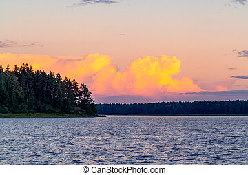 Beautiful clouds over the lake at sunset on a summer day
