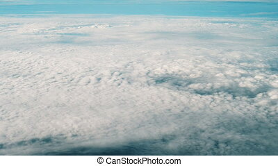 Beautiful clouds recorded from the plane window.