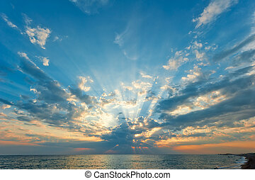 beautiful clouds with the setting sun over the sea