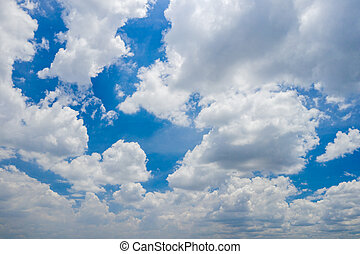 Beautiful cloudscape background with cumulus white clouds and blue sky