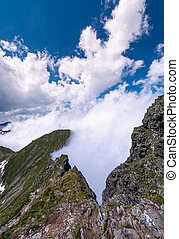 beautiful cloudscape over the cliffs of Fagarasan mountain...