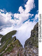 beautiful cloudscape over the cliffs of Fagarasan mountain...