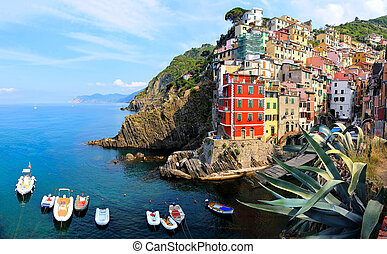 Beautiful coastal village of Riomaggiore with boats, Cinque...