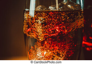 Beautiful cola with ice cubes close up in glass