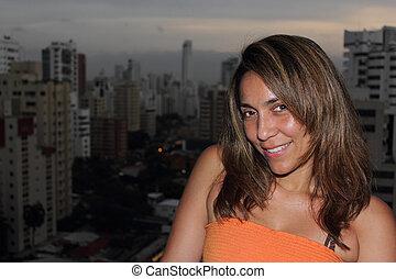 Beautiful Colombian woman city background