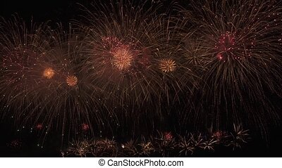 Beautiful colorful fireworks display for celebration on black background, New year holiday concept stock footage video