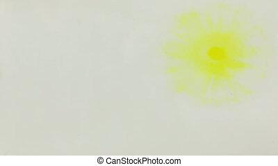 Beautiful colorful ink in water, ink drop. Falling yellow...