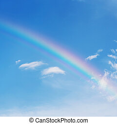 beautiful colorful rainbow on blue sky background