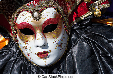 Beautiful coloured image of the fantastic costumes on display on the streets of Venice during carnival