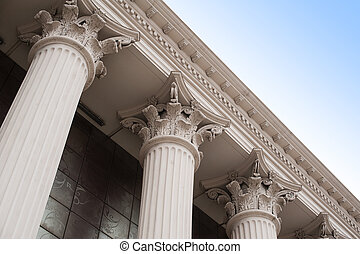 Beautiful columns of the capital on the facade of the historic building