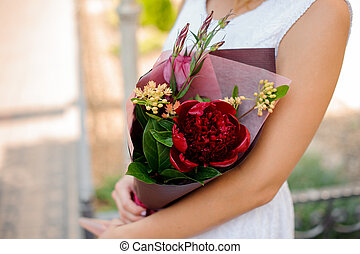 Beautiful combination of colorful flowers in woman hands