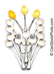 Beautiful composition of dessert spoons and forks on a white...