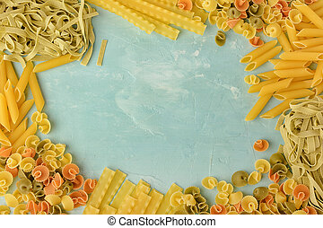 Beautiful composition of pasta with space for text, copy space. Penne, Mafalde, Tagliatelle, Spaghetti lined in a frame on a blue background.