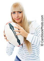 beautiful concentrated girl with a ball