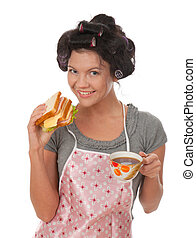cooking woman in apron with sandwich