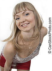Beautiful coquettish girl the blonde on a white background