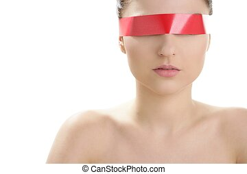 Beautiful cosmetic woman, red tape in eyes