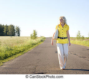 Beautiful country girl walking on the road