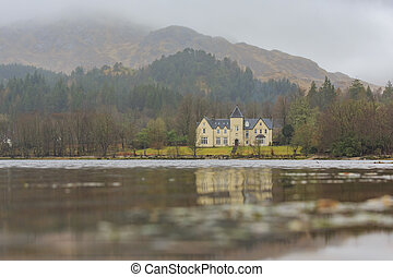 Beautiful country side view with lake at Highland, Scotland