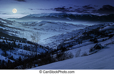 beautiful countryside in mountains at night. village and...