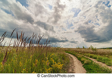 Beautiful countryside landscape with road and clouds