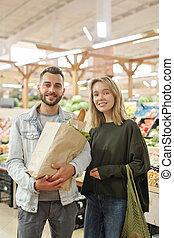 Beautiful couple at modern market