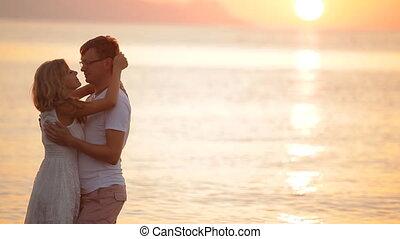 beautiful couple at sunrise on the island of Santorini