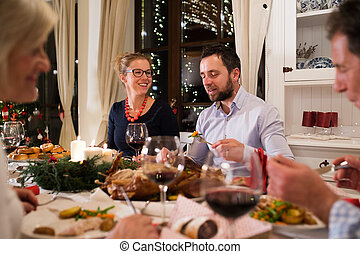 Beautiful couple celebrating Christmas together with the family.