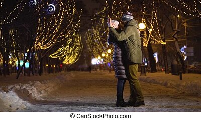 Beautiful couple dance and spin in the falling snow - Happy...