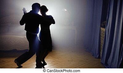 Beautiful couple dancing tango - Passionate couple dancing...