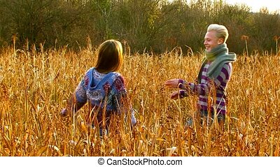 Beautiful Couple Hugging On The Field - SLOW MOTION. Young...