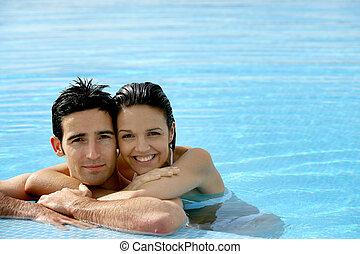 beautiful couple in a swimming pool