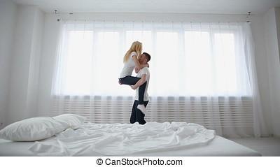 Beautiful couple in love having fun at home