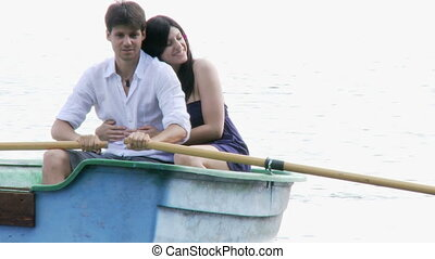 beautiful couple in love on a boat