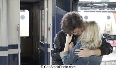 Beautiful Couple In Love Saying Goodbye And Kissing On Train Station  Platform On Rainy Day