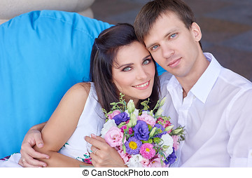 beautiful couple in love sitting on the couch