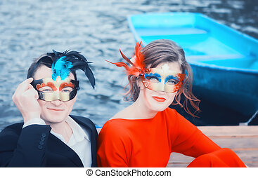 Beautiful Couple In Masquerade Masks