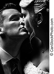 Beautiful couple kissing in black and white