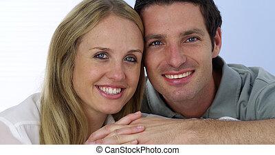 Beautiful couple looking at camera