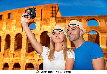 Beautiful couple near Coliseum - Beautiful couple taking...